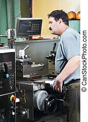 worker at machining tool workshop - mechanical technician...