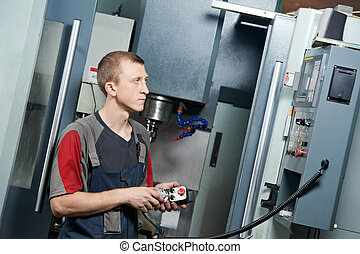 worker at machining tool workshop