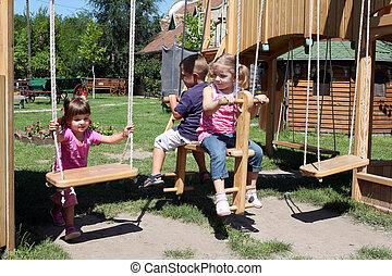 three children on playground
