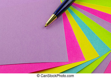 colour notes and blue pen - bright colour notes with a blue...