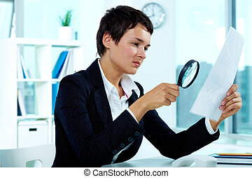 Detective study - Photo of pretty businesswoman looking at...