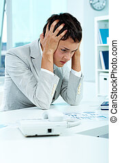 Troubled businesswoman - Image of young employer holding her...