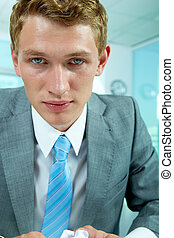Tired man - Portrait of tired businessman looking at camera