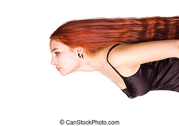 Young girl with a long red hair