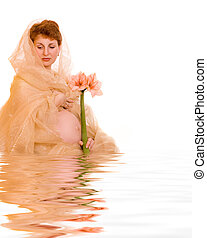 Beautiful young pregnant woman with flower in rendered water