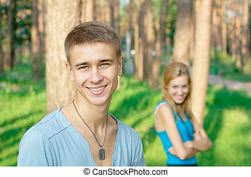 Smiling young boy with a girl