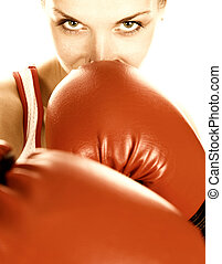 Sepia toned portrait of a girl with red boxing gloves
