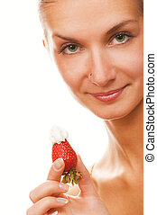 Beautiful girl with a strawberry