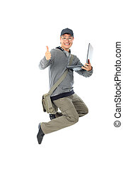 university - Shot of a happy jumping young man. Isolated...