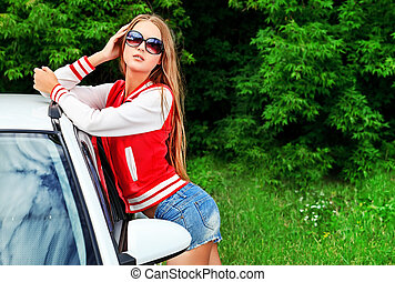weekend - Happy young woman having summer trip on a car.