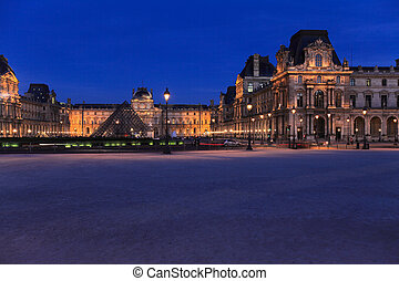 Night view of The Louvre Palace and the Pyramid, Paris,...