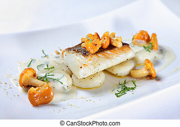 Fish with chanterelle - A close-up of a portion of fish with...