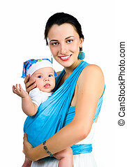 mother carrying her baby in a sling - Beautiful young mother...