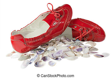 Red lady ballet flat shoes and seashells isolated on white