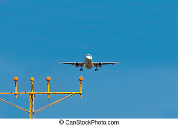 Airplane landing - A landing airplane with landing lights on...