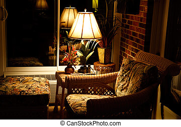 Comfortable evening chair & ottoman at night - A...