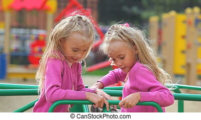 Children on playground - Mother playing with her daughters...