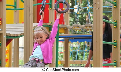 Funny chute - Two little children sliding on chute in...