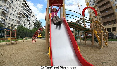 Children on slide - Children spending time in playground...