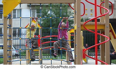 Brave kids - Two little girls spending time in playground