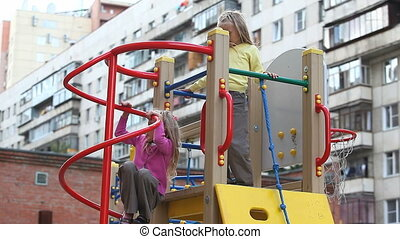 Monkeys - Two little girls climbing on playground net