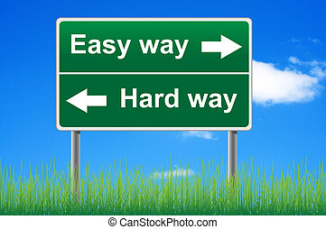 Easy way, hard way. Concept road sign on sky background.