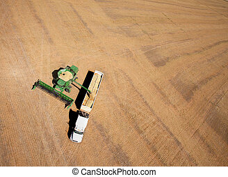 Harvest - Aerial view of a field being harvested - a combine...