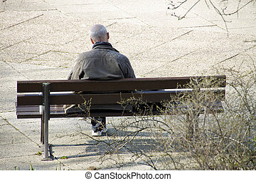 Reading man sitting on a bench