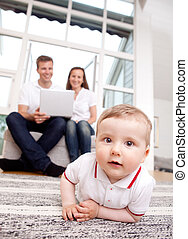 Curious Baby - A happy curious young baby boy with parents...