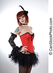 Cabaret girl in red corset and tutu skirt
