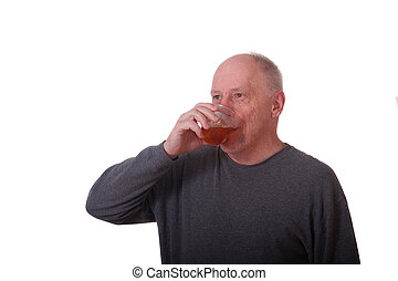 Older Balding Man in Gray Shirt Drinking Iced Tea - An older...