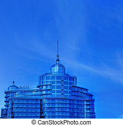 Urban office building over blue sky