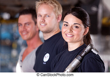 Mechanic Team with Woman - Portrait of a team of mechanics...
