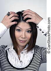 Asian woman touching hair