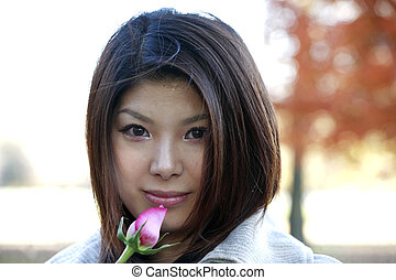 Asian girl with rose