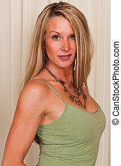 Tank top - Beautiful mature blonde in a green tank top