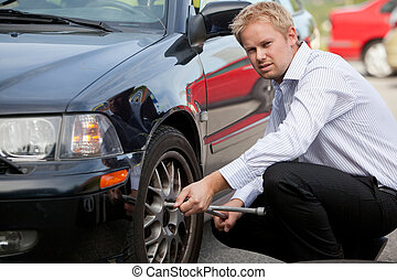 Business Man Tire Change - An unhappy business man changing...