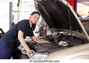 Mechanic Woman - Portrait of a happy mechanic woman working...