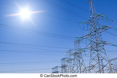 Transmission line support on blue sky background.