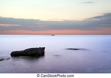 Sea and rock at the sunset.