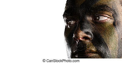 young soldier face with jungle camouflage on white...