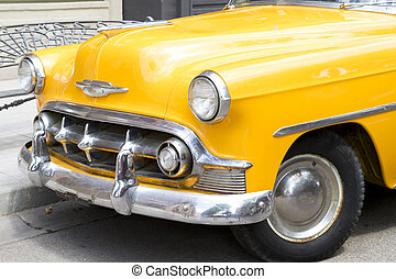 yellow 50s old car - yellow 50s vintage car parked in the...