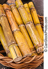 Sugarcane in basket - Green sweet sugarcane in wooden basket...