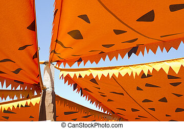 cartoonish orange awning to prevent the sunshine from...