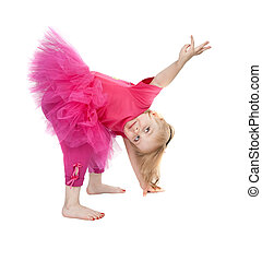 little girl in a pink dress dancing in the studio bow...