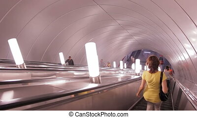 The escalator ride into the subway, St Petersburg, Russia -...