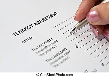Tenancy Agreement - Lady completing a tenancy agreement form