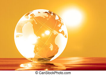 Planet - Glass globe with bright highlights on a yellow...