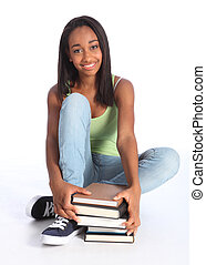 Beautiful black teenage girl with school books