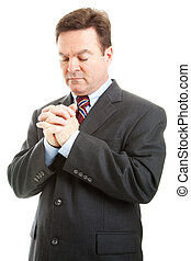 Businessman in Prayer - Businessman or minister with hands...